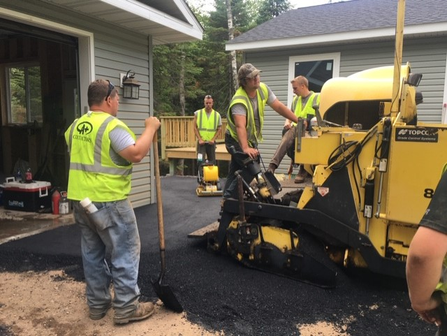 group of aplus contractor workers working on asphalt in the twin ports